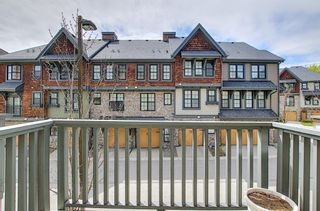 Photo 32: 314 Ascot Circle SW in Calgary: Aspen Woods Row/Townhouse for sale : MLS®# A1111264