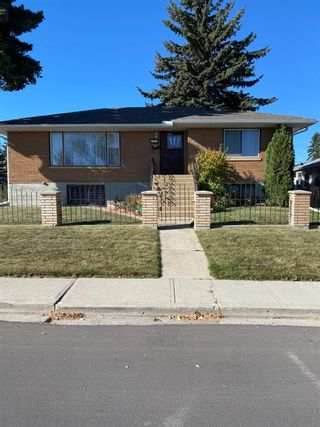 Photo 1: 945 42 Street SW in Calgary: Rosscarrock Detached for sale : MLS®# A1152996
