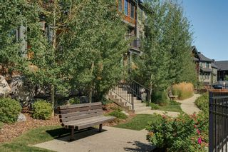 Photo 2: 111 Ascot Point SW in Calgary: Aspen Woods Row/Townhouse for sale : MLS®# A1144877