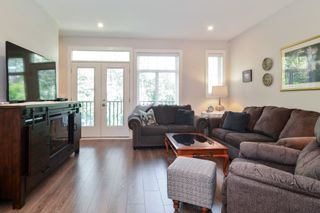 """Photo 3: 82 7665 209 Street in Langley: Willoughby Heights Townhouse for sale in """"Archstone"""" : MLS®# R2594119"""
