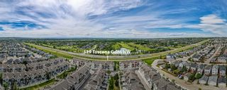 Photo 5: 119 Toscana Gardens NW in Calgary: Tuscany Row/Townhouse for sale : MLS®# A1121039
