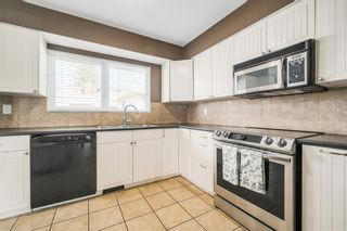 Photo 5: 7407 Fountain Road SE in Calgary: Fairview Detached for sale : MLS®# A1103326
