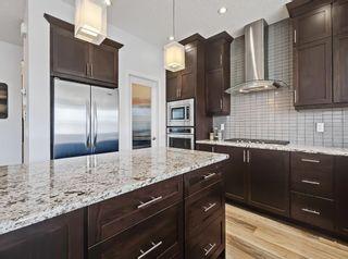 Photo 7: 184 Auburn Springs Close SE in Calgary: Auburn Bay Detached for sale : MLS®# A1091230