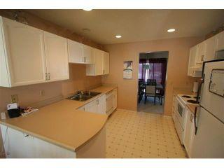 Photo 2: 146 388 SANDARAC Drive NW in CALGARY: Sandstone Townhouse for sale (Calgary)  : MLS®# C3460112