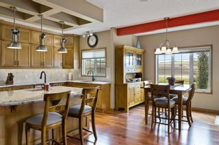 Photo 18: Spacious and Beautiful Valley Ridge Home backing out on to the Ravine