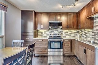 Photo 7: 207 STRATHEARN Crescent SW in Calgary: Strathcona Park House for sale : MLS®# C4165815