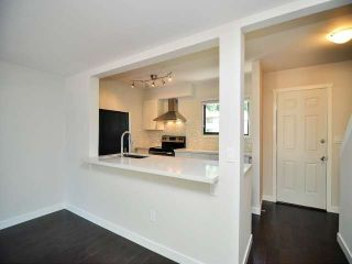 "Photo 6: 887 CUNNINGHAM Lane in Port Moody: North Shore Pt Moody Townhouse for sale in ""WOODSIDE VILLAGE"" : MLS®# V1021537"