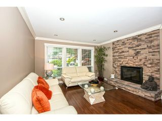 Photo 2: 1622 HEMLOCK Place in Port Moody: Mountain Meadows House for sale : MLS®# V1127052