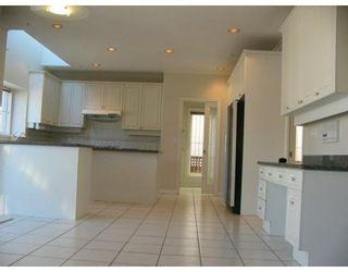 Photo 8: 1521 W 61ST AV in Vancouver West: Home for sale : MLS®# V608796