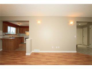 Photo 8: 74 WEST TERRACE Road: Cochrane House for sale : MLS®# C4073559