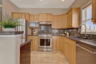 Photo 9: 5 STRADDOCK Villa SW in Calgary: Strathcona Park Semi Detached for sale : MLS®# C4293573