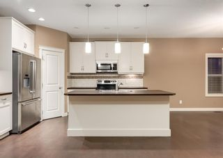 Photo 9: 150 AUTUMN Circle SE in Calgary: Auburn Bay Detached for sale : MLS®# A1089231