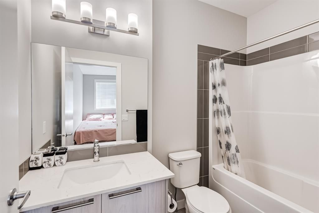 Photo 14: Photos: 125 Redstone Crescent NE in Calgary: Redstone Row/Townhouse for sale : MLS®# A1124721
