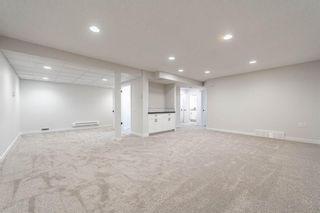 Photo 28: 128 Oakbriar Close SW in Calgary: Palliser Semi Detached for sale : MLS®# A1141127