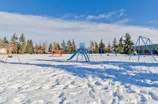 Photo 7: 99 3809 45 Street SW in Calgary: Glenbrook Row/Townhouse for sale : MLS®# A1066795