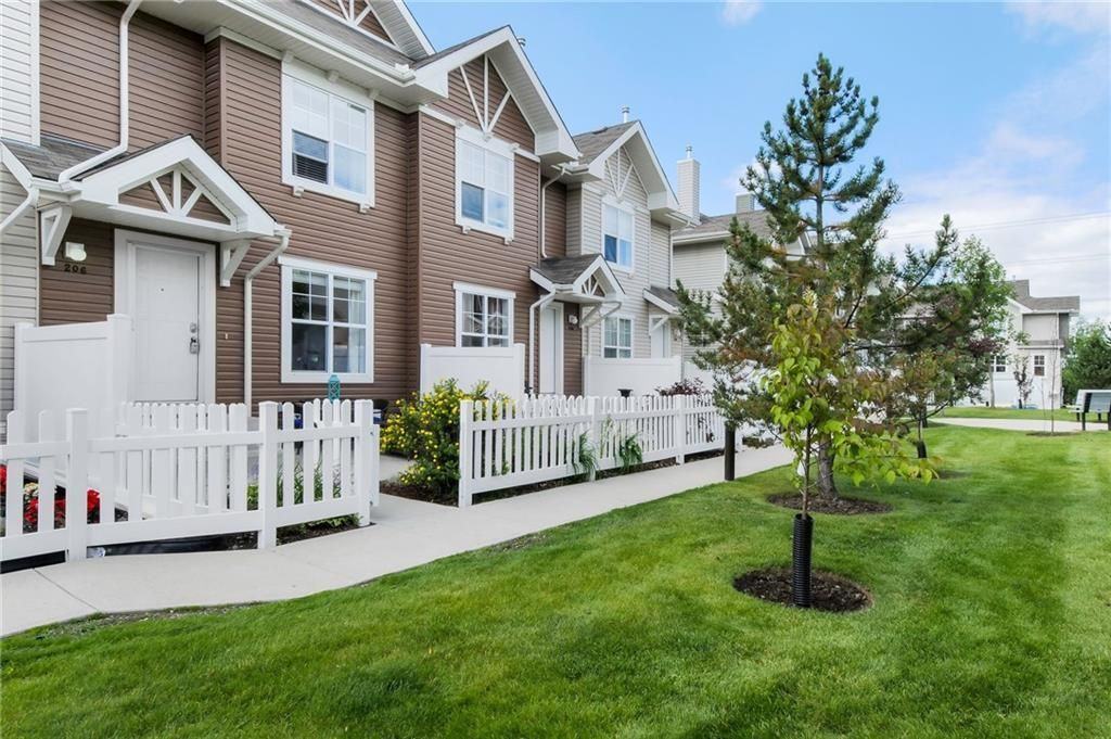 Main Photo: 206 TOSCANA Gardens NW in Calgary: Tuscany Row/Townhouse for sale : MLS®# A1088865