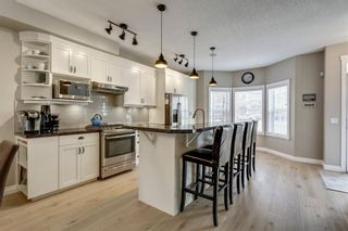Photo 4: 93 SOMME Boulevard SW in Calgary: Garrison Woods Row/Townhouse for sale : MLS®# C4241800