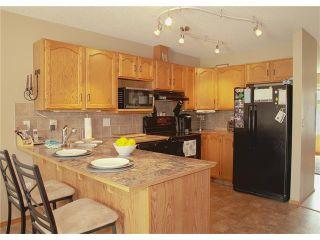 Photo 7: 8 105 ELM Place: Okotoks House for sale : MLS®# C4024142