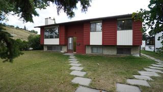 Photo 1: 2 GLENBROOK Crescent: Cochrane Detached for sale : MLS®# A1027996