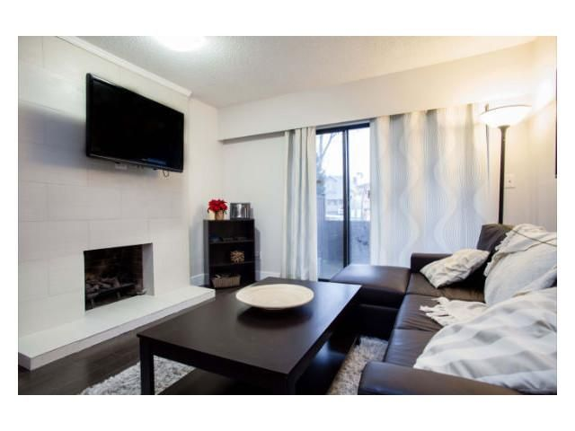 """Main Photo: 102 2299 E 30TH Avenue in Vancouver: Collingwood VE Condo for sale in """"TWIN COURT"""" (Vancouver East)  : MLS®# V1010933"""