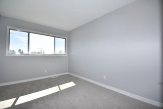 Photo 23: 5 903 67 Avenue SW in Calgary: Kingsland Row/Townhouse for sale : MLS®# A1115343