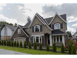 Photo 1: 720 COMO LAKE Avenue in Coquitlam: Coquitlam West House for sale : MLS®# V1072916