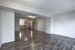 Photo 9: 25 200 HIDDEN HILLS Terrace in Calgary: Hidden Valley Row/Townhouse for sale : MLS®# A1022696