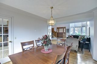 Photo 9: 185 Strathcona Road SW in Calgary: Strathcona Park Detached for sale : MLS®# A1113146