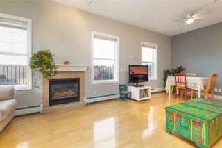 Photo 3: 101 248 SUNTERRA RIDGE Place: Cochrane Apartment for sale : MLS®# C4294936