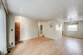 Photo 5: 3128 45 Street SW in Calgary: Glenbrook Detached for sale : MLS®# A1063846