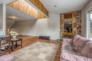 Photo 12: 10 Coach  Manor Rise SW in Calgary: Coach Hill Row/Townhouse for sale : MLS®# A1077472