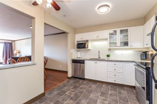 """Photo 7: 410 33731 MARSHALL Road in Abbotsford: Central Abbotsford Condo for sale in """"Stephanie Place"""" : MLS®# R2590546"""