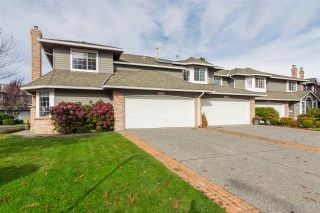 "Photo 1: 6117 W BOUNDARY Drive in Surrey: Panorama Ridge Townhouse for sale in ""LAKEWOOD GARDENS"" : MLS®# R2318441"