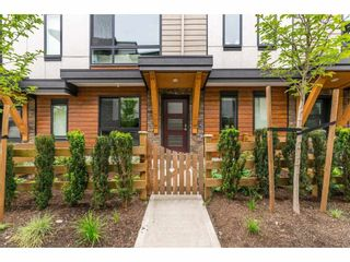 """Photo 2: 209 16488 64 Avenue in Surrey: Cloverdale BC Townhouse for sale in """"Harvest"""" (Cloverdale)  : MLS®# R2376091"""