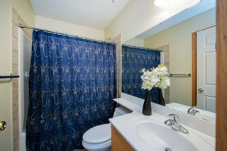 Photo 16: 101 72 Quigley Drive: Cochrane Apartment for sale : MLS®# A1091486