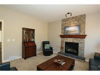Photo 7: 188 SUNSET Close: Cochrane House for sale : MLS®# C4115906
