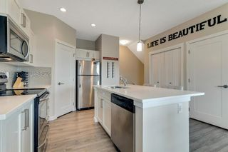 Photo 6: 303 428 Nolan Hill Drive NW in Calgary: Nolan Hill Row/Townhouse for sale : MLS®# A1141583