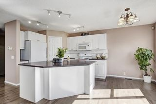 Photo 8: 147 TUSCANY HILLS Circle NW in Calgary: Tuscany House for sale : MLS®# C4115208