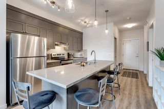 Photo 5: 104 30 Shawnee Common SW in Calgary: Shawnee Slopes Apartment for sale : MLS®# A1099308