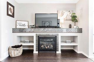 Photo 5: 76 Fireside Way: Cochrane Semi Detached for sale : MLS®# A1076919