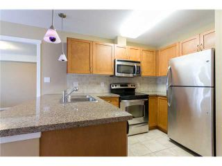 """Photo 5: 306 2373 ATKINS Avenue in Port Coquitlam: Central Pt Coquitlam Condo for sale in """"CARMANDY"""" : MLS®# V1069079"""