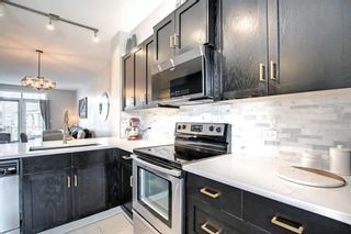 Photo 18: 1103 125 Panatella Way NW in Calgary: Panorama Hills Row/Townhouse for sale : MLS®# A1143179