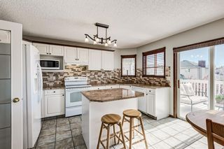 Photo 1: 34 Arbour Crest Close NW in Calgary: Arbour Lake Detached for sale : MLS®# A1116098