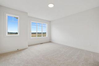 Photo 14: 101 Heartland Street: Cochrane Semi Detached for sale : MLS®# A1095665