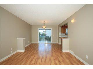 Photo 10: 74 WEST TERRACE Road: Cochrane House for sale : MLS®# C4073559