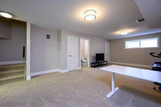 Photo 29: 524 Quarry Park Boulevard SE in Calgary: Douglasdale/Glen Row/Townhouse for sale : MLS®# A1084098