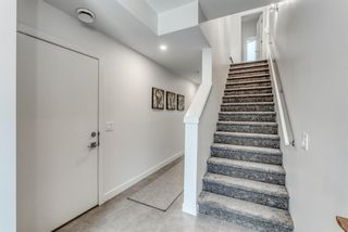 Photo 2: 98 23 Street NW in Calgary: West Hillhurst Row/Townhouse for sale : MLS®# A1066637