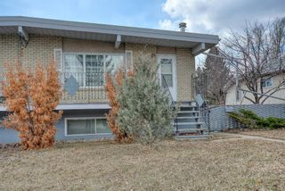 Main Photo: 2015 51 Avenue SW in Calgary: North Glenmore Park Semi Detached for sale : MLS®# A1095115