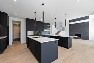 Photo 15: 7853 8a Avenue SW in Calgary: West Springs Detached for sale : MLS®# A1120136