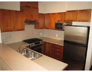 Photo 3: 417 2969 WHISPER Way in Coquitlam: Westwood Plateau Condo for sale : MLS®# V785049